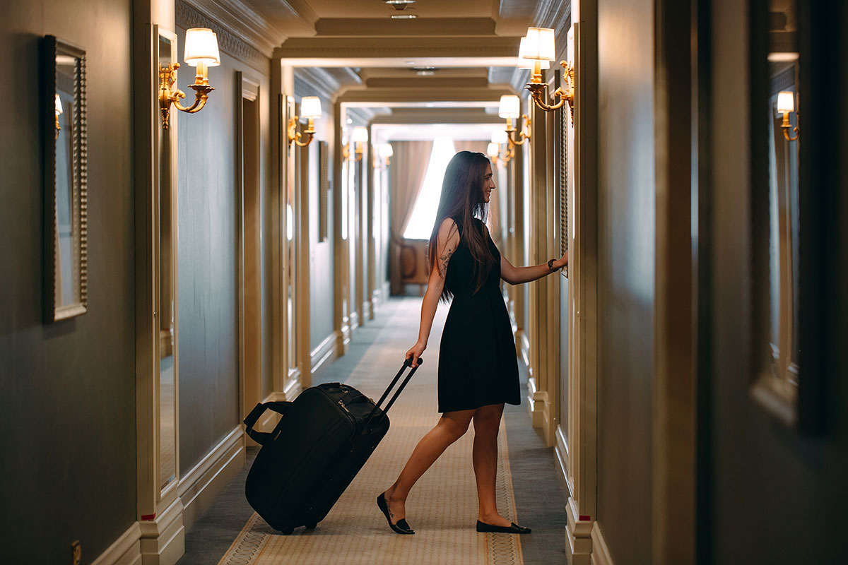 Woman going to hotel room