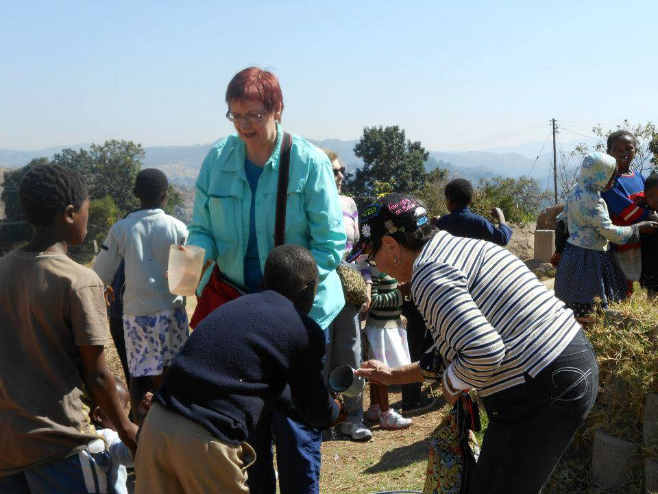 Marti S working at the feeding center in Swaziland