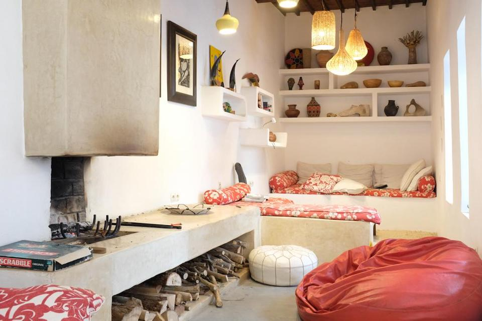 Nooks and crannies stuffed with pillows and objets d'art make this space cozy and interesting