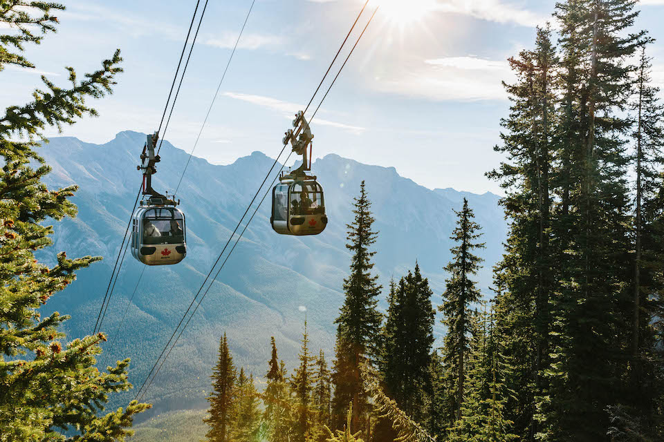 Two cable cars riding along a gondola in Banff