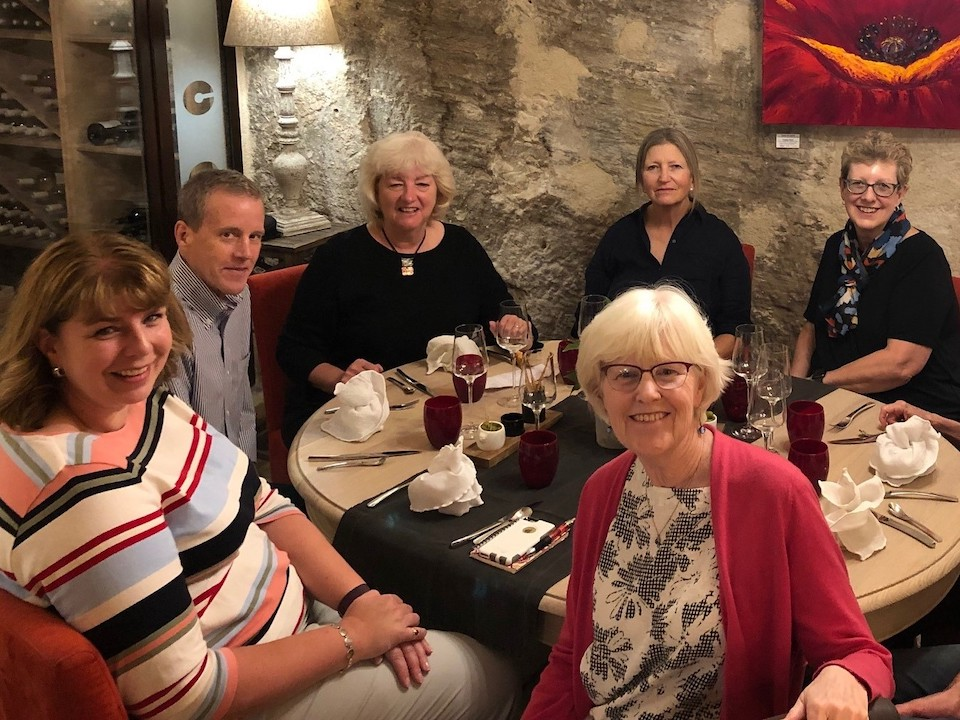 A group of travellers enjoying a meal with European Experiences
